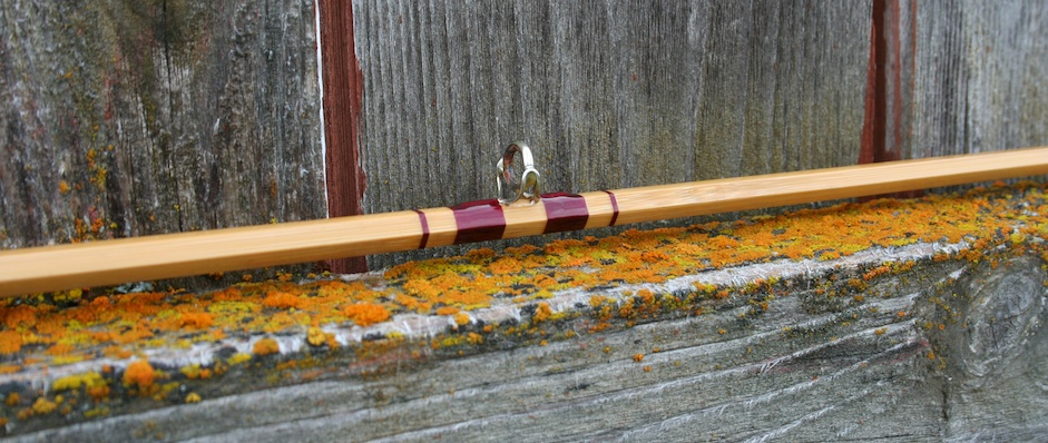 bamboo fly rod on fence